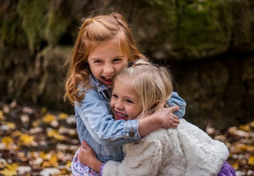 sisters hugging on sisters day